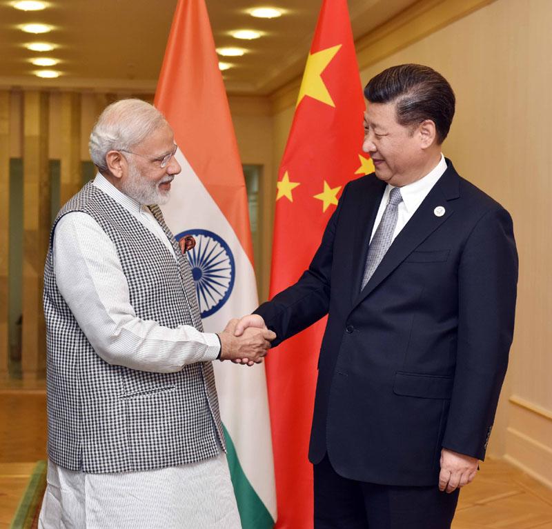 The Prime Minister, Shri Narendra Modi meeting the President of the People's Republic of China, Mr. Xi Jinping, in Tashkent, Uzbekistan on June 23, 2016.