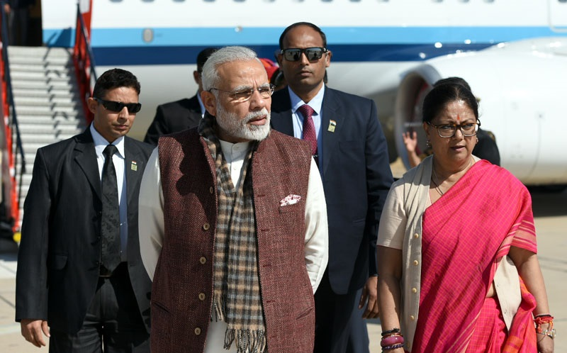 The Prime Minister, Shri Narendra Modi being welcomed by the Chief Minister of Rajasthan, Smt. Vasundhara Raje, on his arrival at Uttarlai Air Force Station, in Barmer, Rajasthan on January 16, 2018.