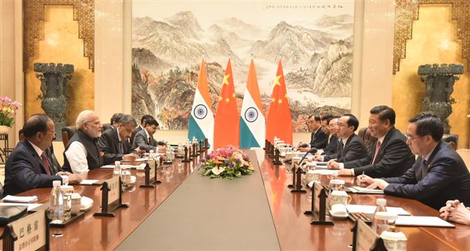 The Prime Minister, Shri Narendra Modi meeting the President of the People's Republic of China, Mr. Xi Jinping, at the East Lake Guest House, in Wuhan, China on April 27, 2018.