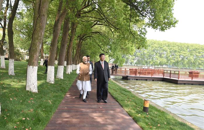 The Prime Minister, Shri Narendra Modi and the President of the People's Republic of China, Mr. Xi Jinping take a walk together along the East Lake, in Wuhan, China on April 28, 2018.