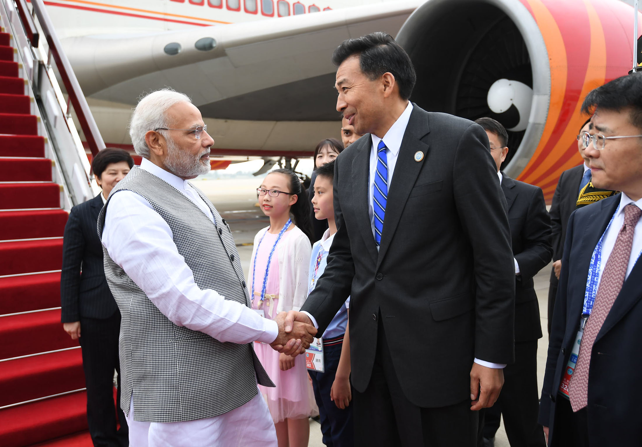 The Prime Minister, Shri Narendra Modi being welcomed by the dignitaries, on his arrival at Qingdao, China, to attend the Shanghai Cooperation Organisation Summit, on June 09, 2018.