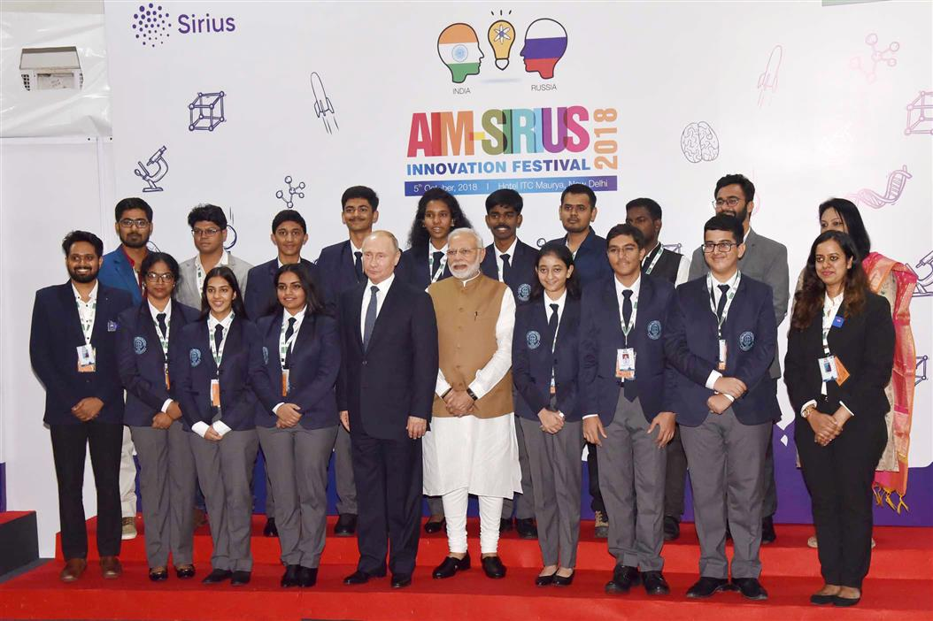 The Prime Minister, Shri Narendra Modi and the President of Russian Federation, Mr. Vladimir Putin in a group photograph with the talented children, in New Delhi on October 05, 2018.