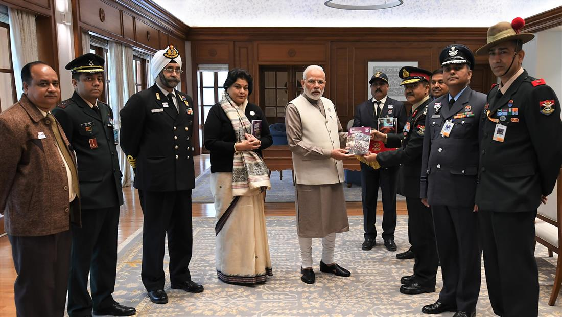 An officer of Kendriya Sainik Board, MoD pinning a flag on the Prime Minister, Shri Narendra Modi, on occasion of the Armed Forces Flag Day, in New Delhi on December 07, 2018.