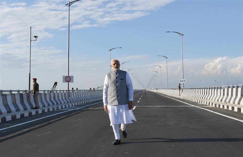 PM dedicates Bogibeel bridge to the nation; flags off first passenger train