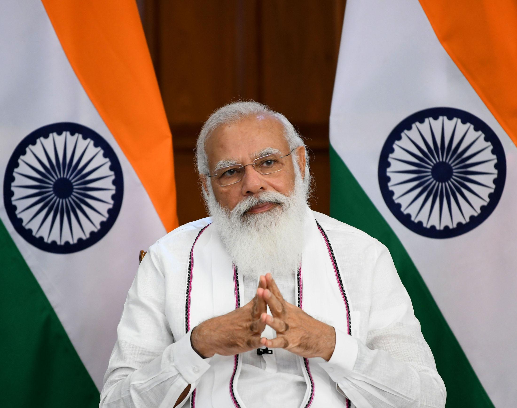 The Prime Minister, Shri Narendra Modi interacts with the beneficiaries of Pradhan Mantri Garib Kalyan Anna Yojana in Gujarat, through video conferencing, in New Delhi on August 03, 2021.